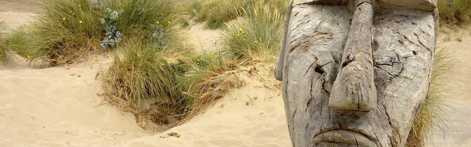 The Carved Head on Barmouth Beach